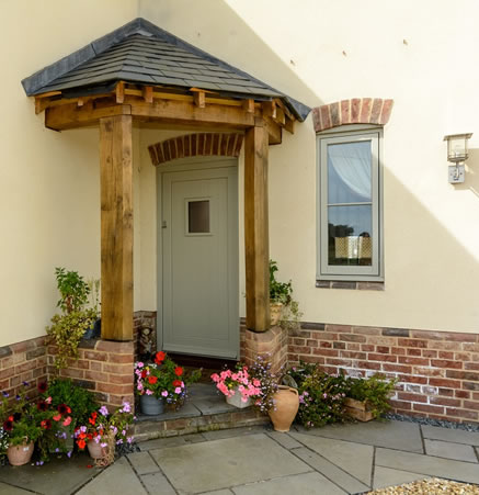 Timber front door in traditionally styled new build